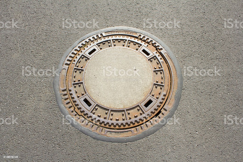 Canal lid on the street in Germany stock photo