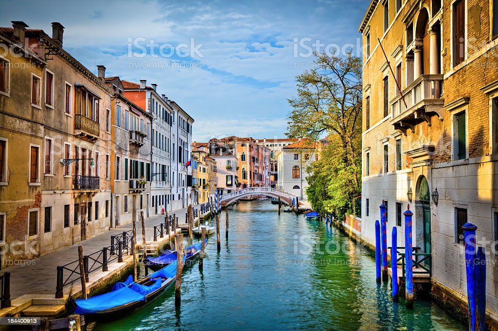 Canal of Venice and Gondolas on a Sunny Day, Italy royalty-free stock photo