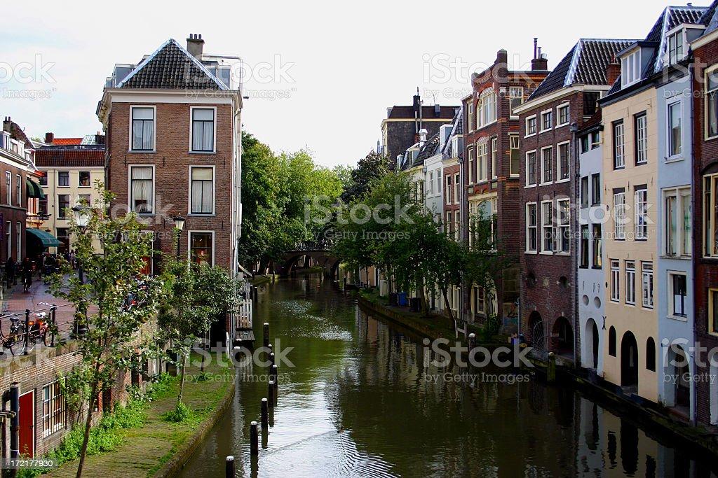 Canal running through Utrecht on an overcast day stock photo