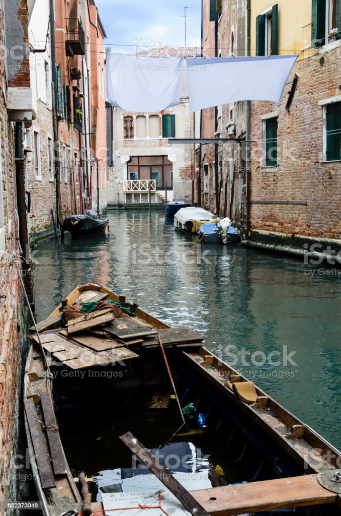 canal view in venice with a boat stock photo