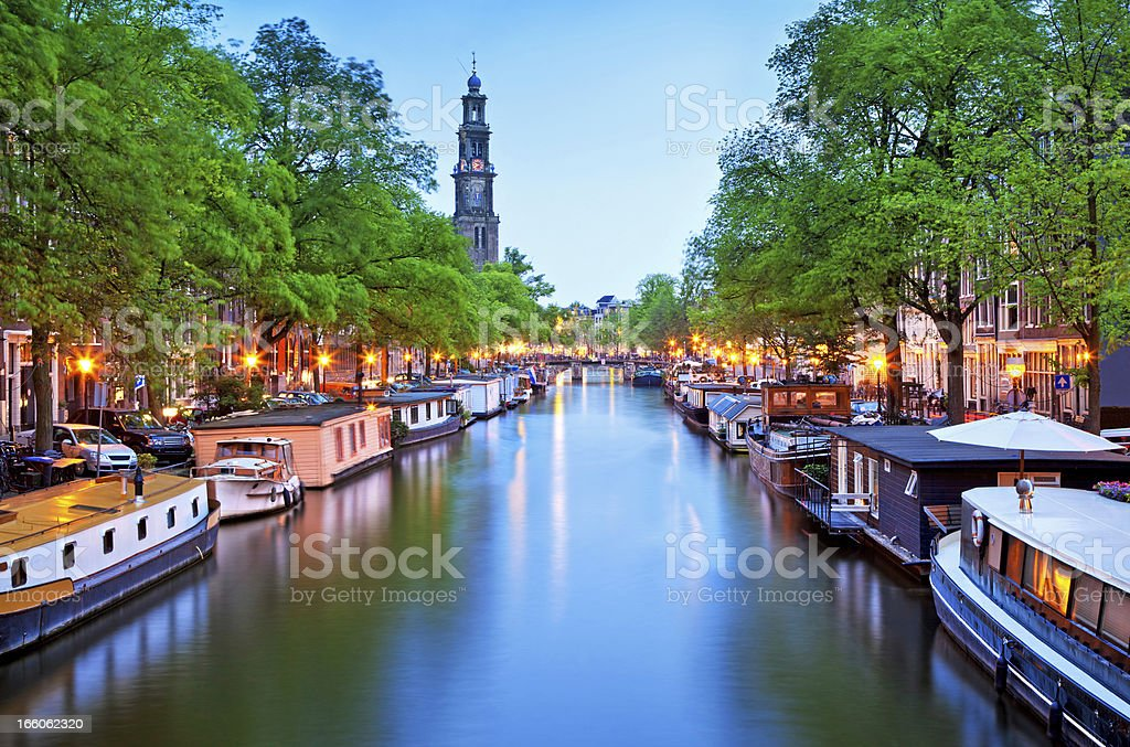 Canal view of houseboats in Amsterdam stock photo