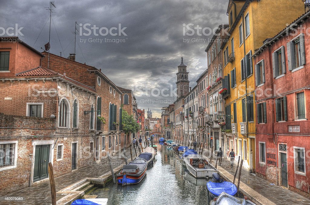 Canal with ancient houses, and boats, Venice, Italy (H stock photo