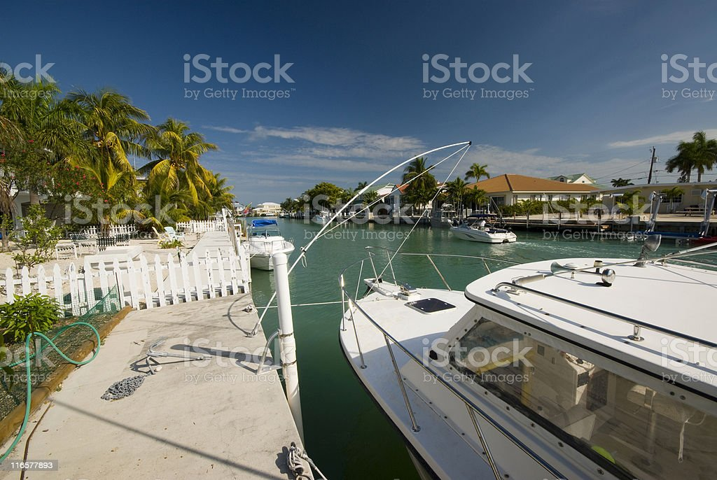 canal with boats and homes florida keys stock photo