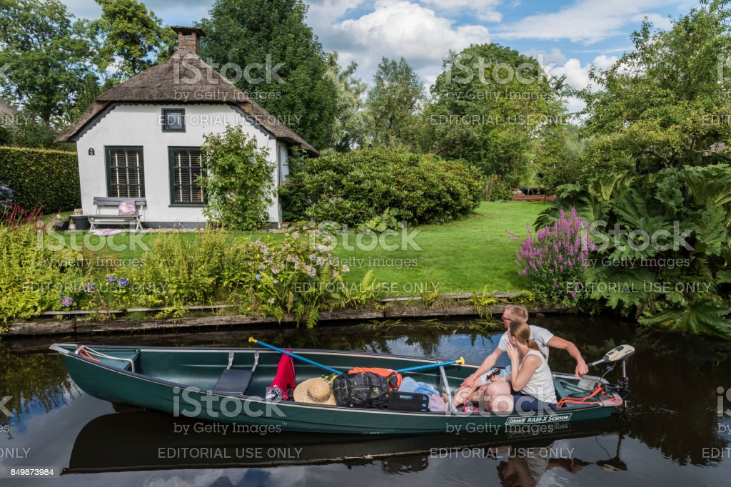 Canal with Electric Boat at Giethoorn stock photo