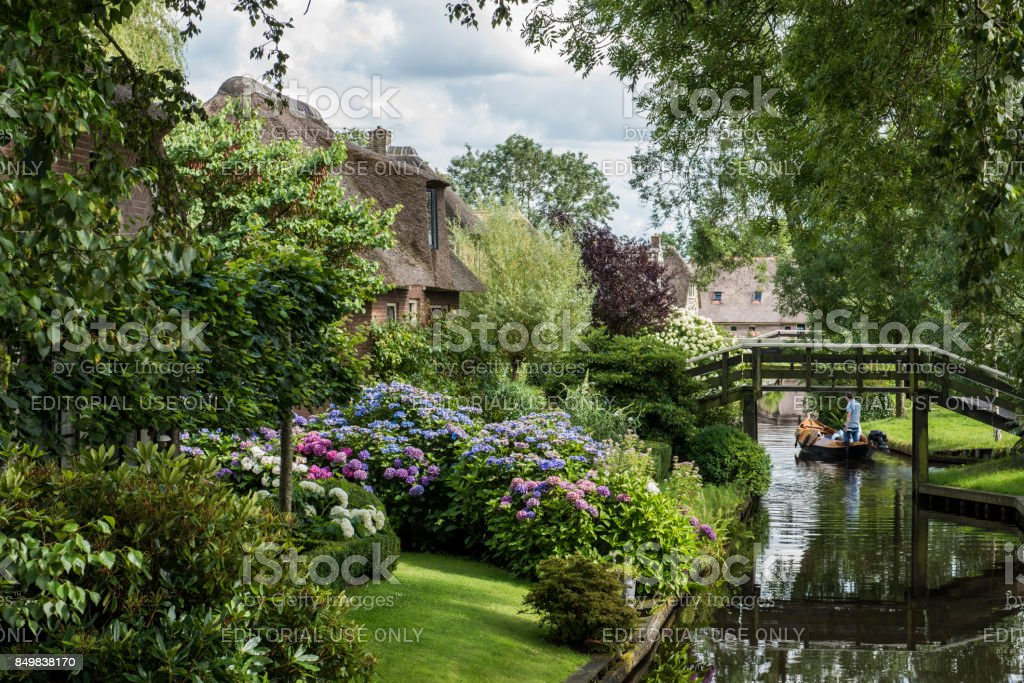 Canal with Hydrangea at Giethoorn stock photo