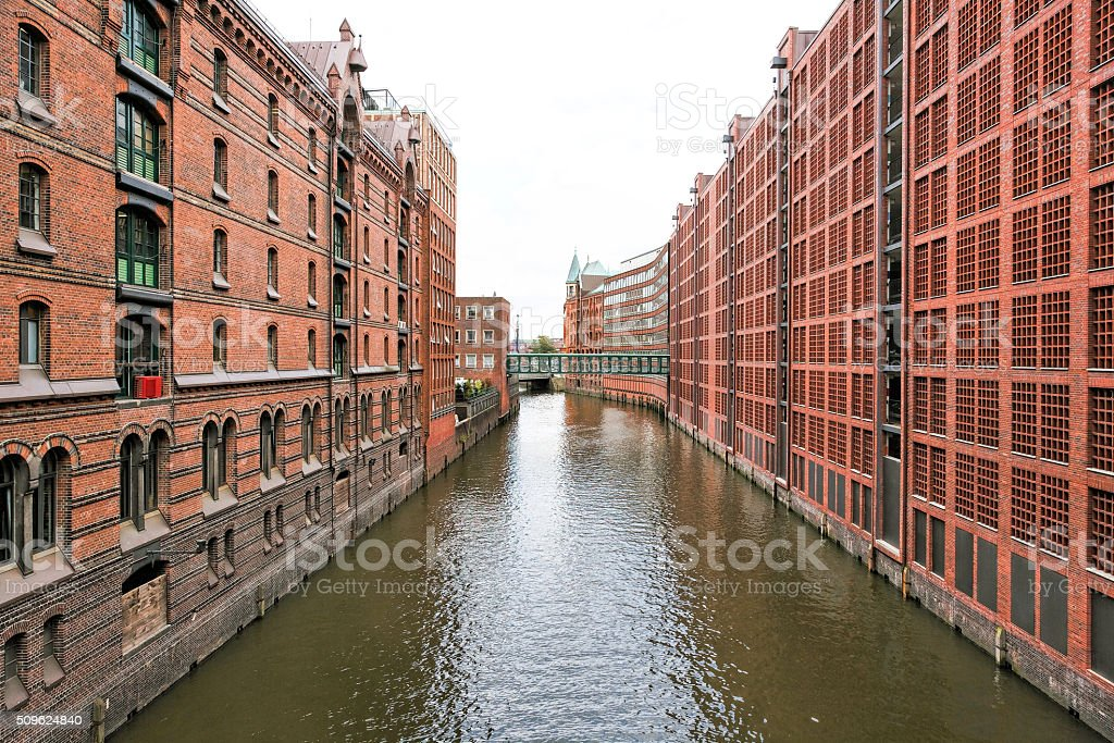 Canal with restored traditional buildings in Hamburg (Speicherstadt) stock photo