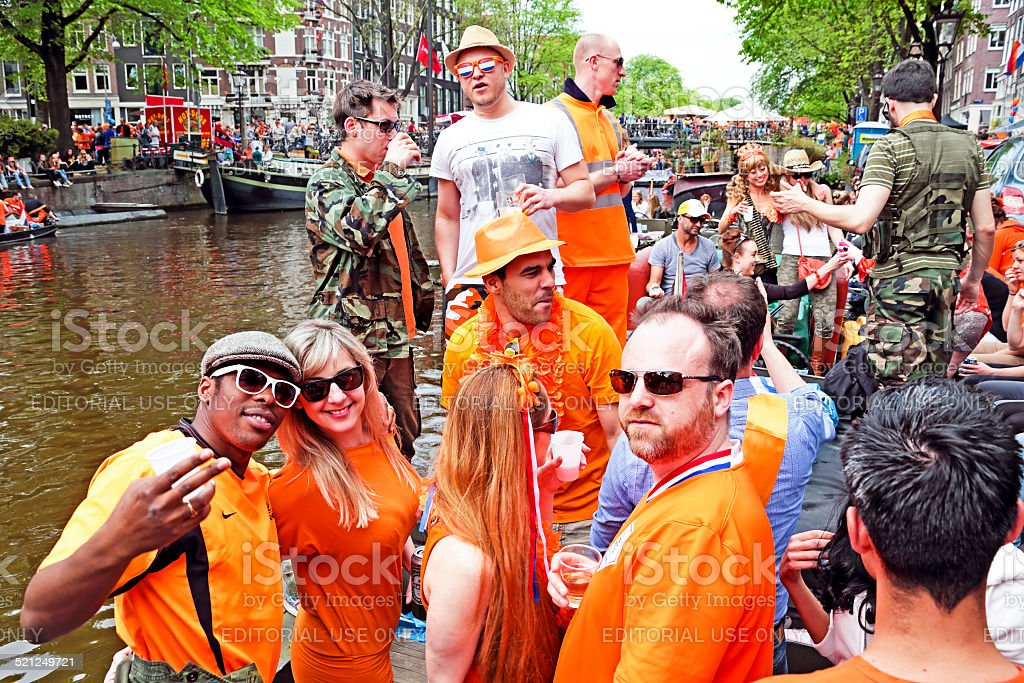 Canals full of boats and people at kingsday in Netherlands stock photo