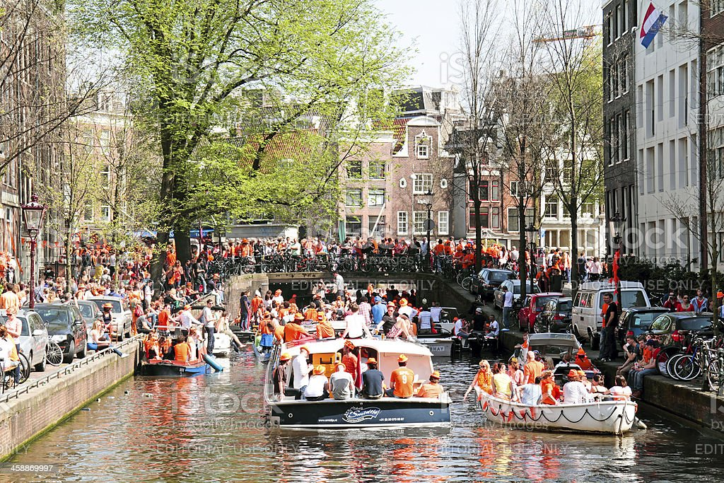 Canals full of boats to celebrate queensday in Amsterdam Netherlands stock photo