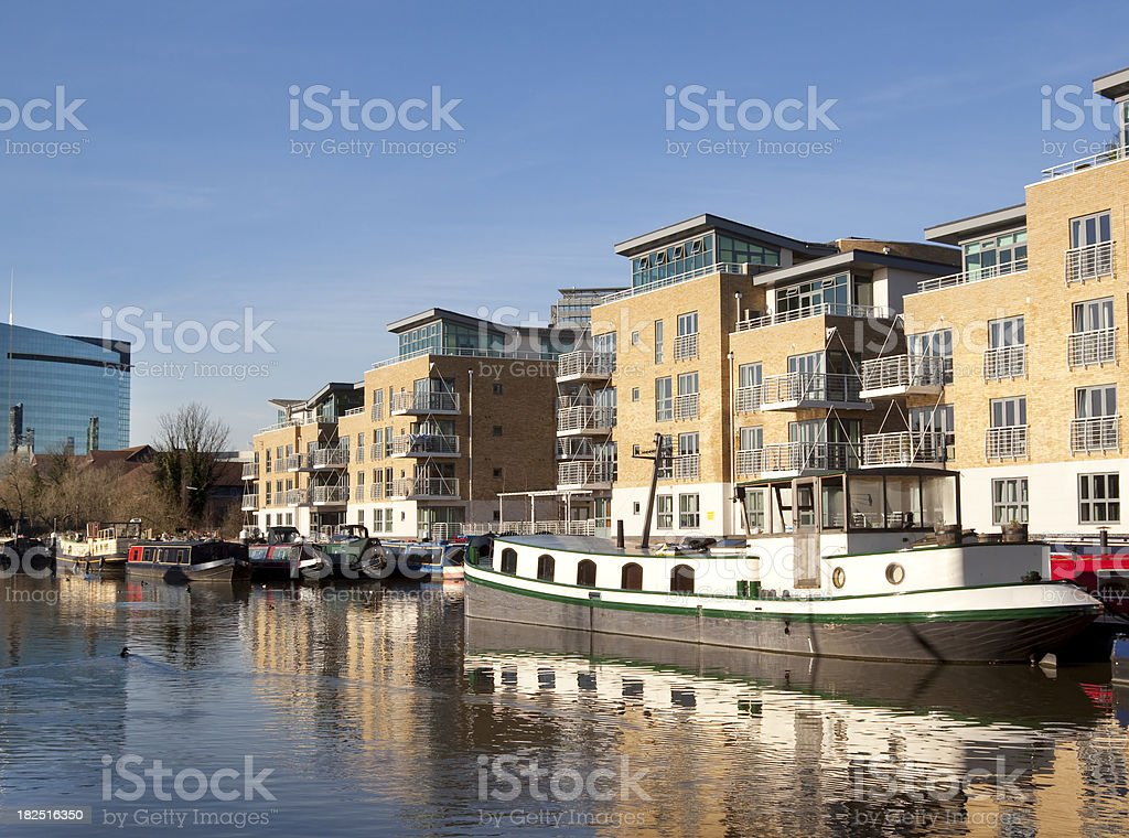 Canalside apartment buildings and boats stock photo