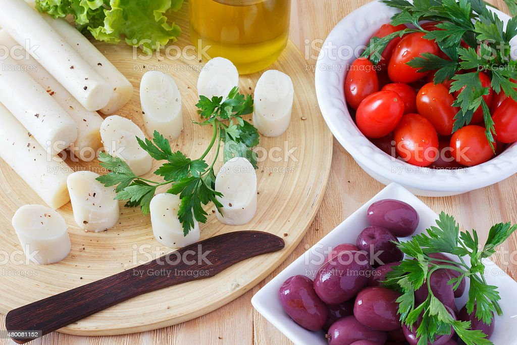 Canape of Heart of palm (palmito), cherry tomatos, olives stock photo