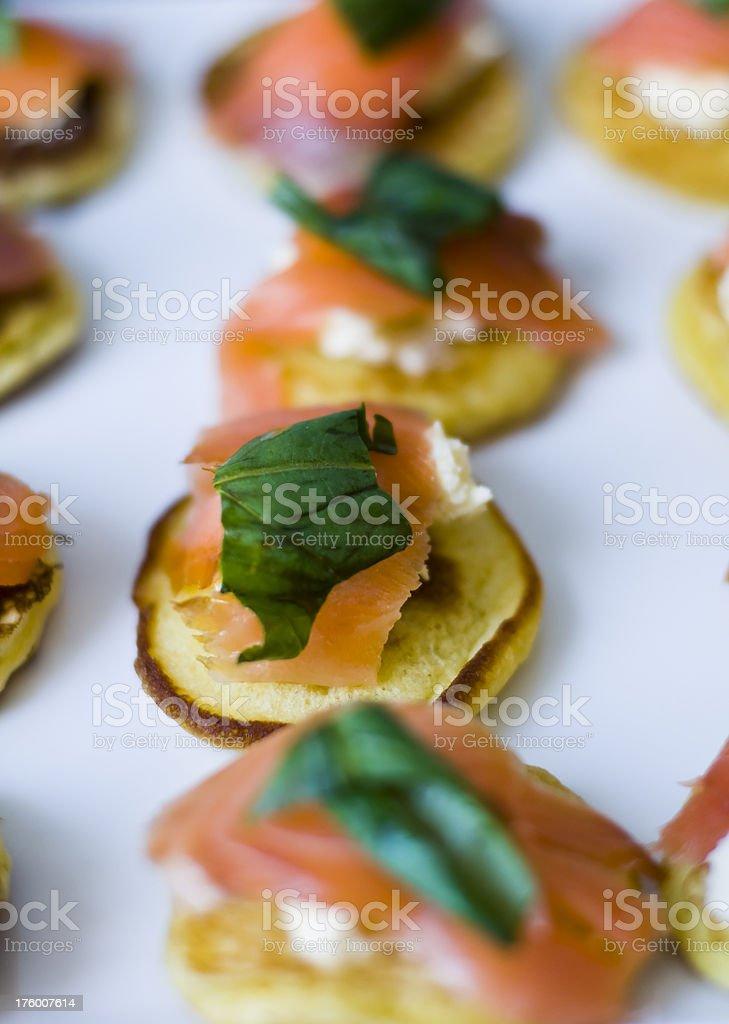 Canape Salmon mascapone basil bilini royalty-free stock photo