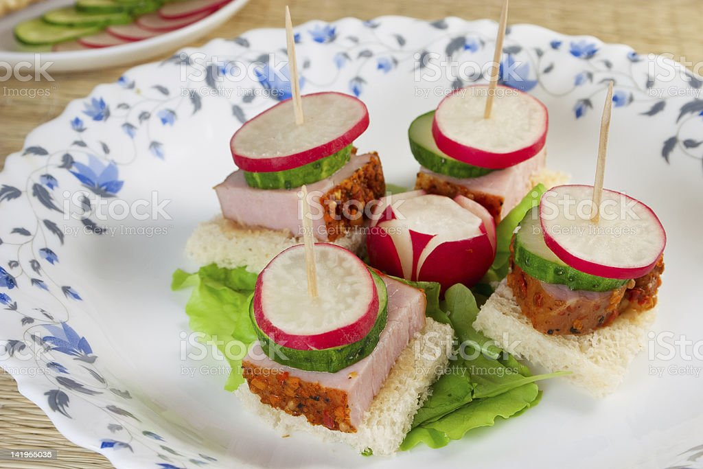 Canape sandwich with radishes ham cucumber stock photo for Canape sandwich