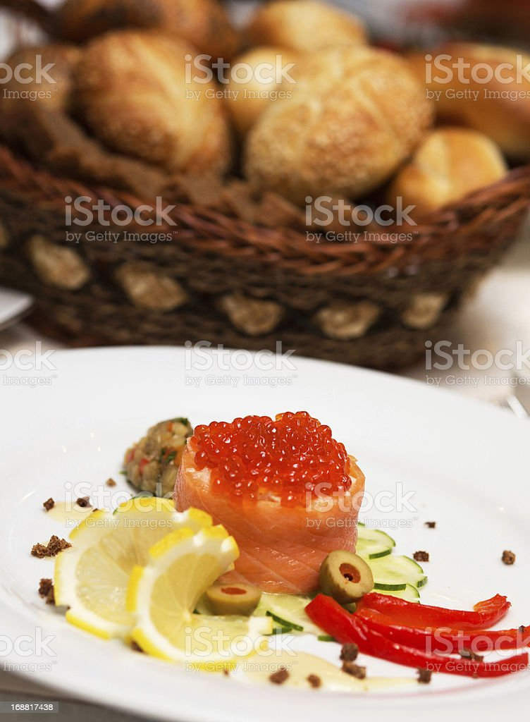 Canape with red caviar and salmon stock photo