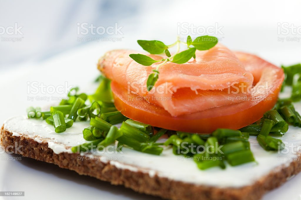 A canape with salmon on tomato royalty-free stock photo