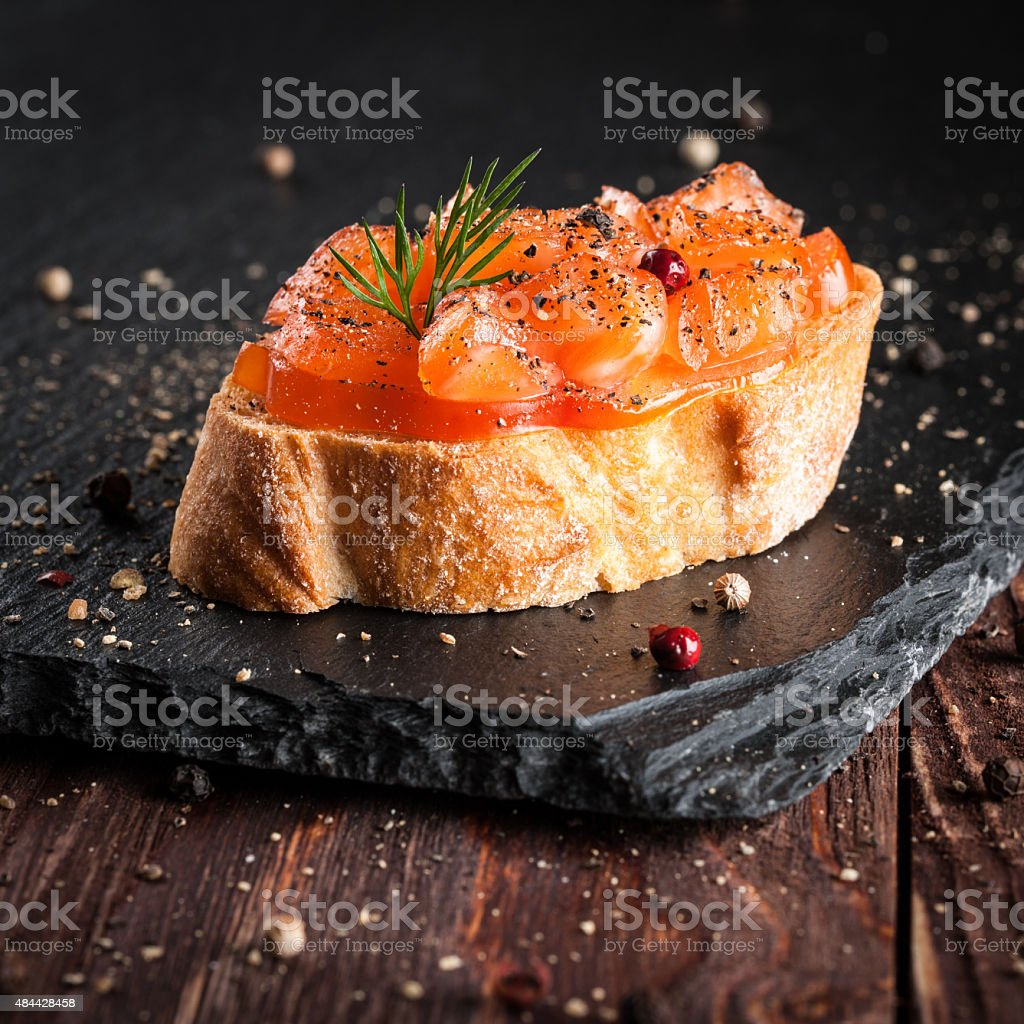 Canape with smoked salmon stock photo