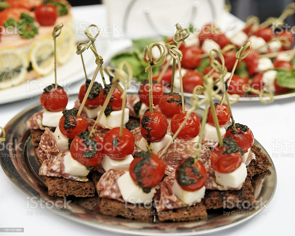 Canapes with choriso wurst on table stock photo