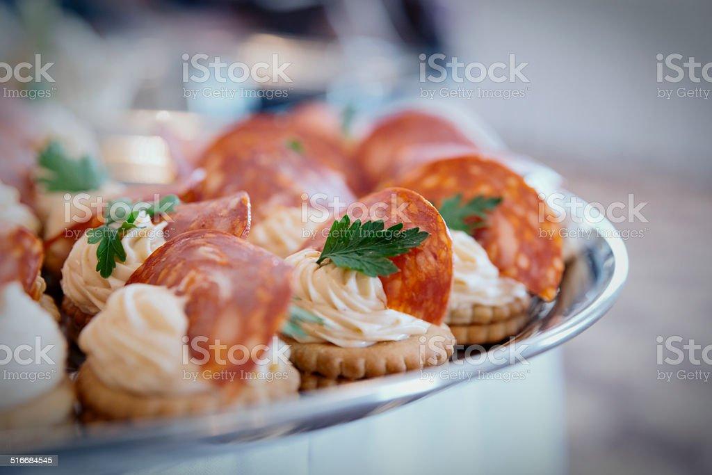 Canapes with choriso wurst, toned stock photo