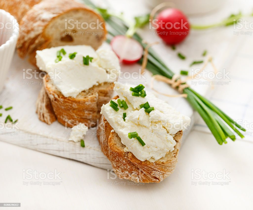 Canapes with curd cheese and fresh chive stock photo