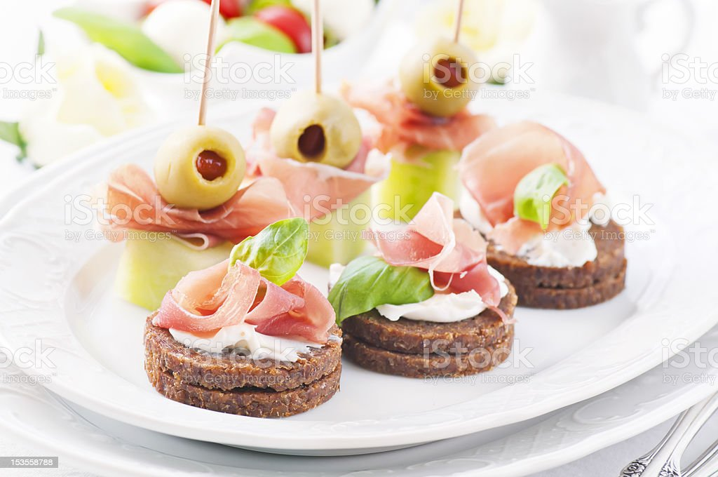 Canapes with Ham and Olives royalty-free stock photo
