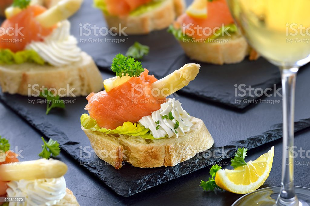 Canapes with salmon and asparagus stock photo