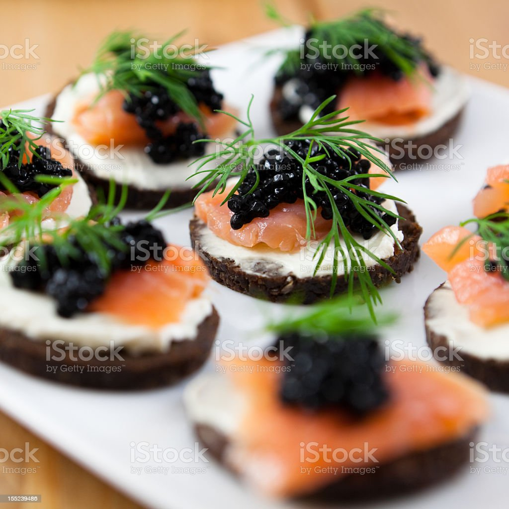 Canapes with salmon and caviar stock photo