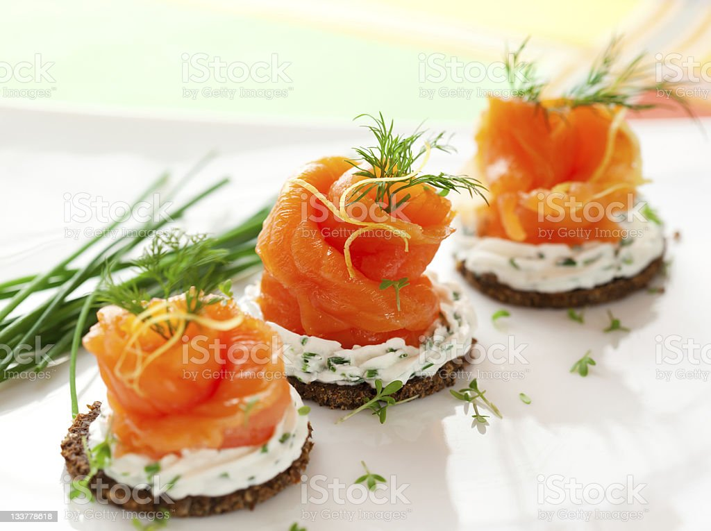 Canapes with smoked salmon stock photo