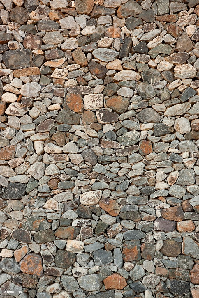 Canarian natural stone wall with multicolored stones royalty-free stock photo