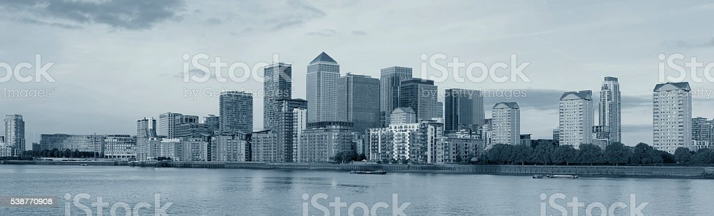 Canary Wharf steel grey panoramic skyline in London stock photo