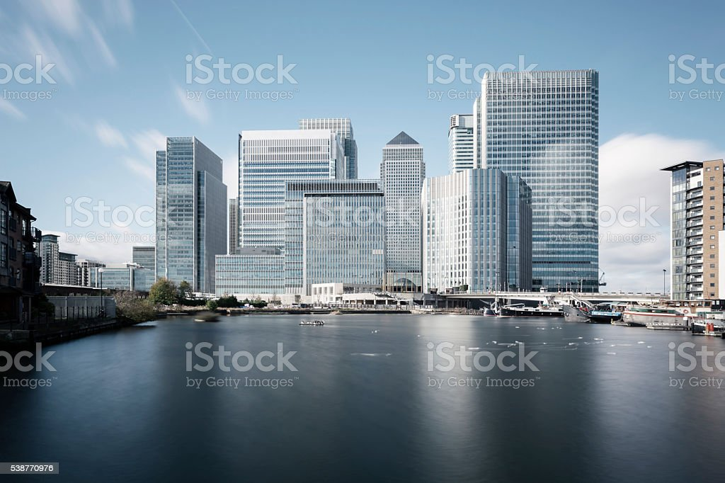 Canary Wharf steel grey skyline in London stock photo