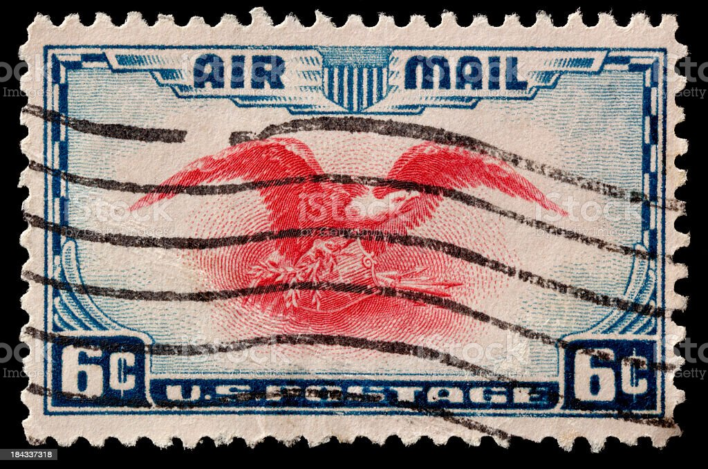 Canceled Airmail Postage Stamp. Isolated on Black. royalty-free stock photo