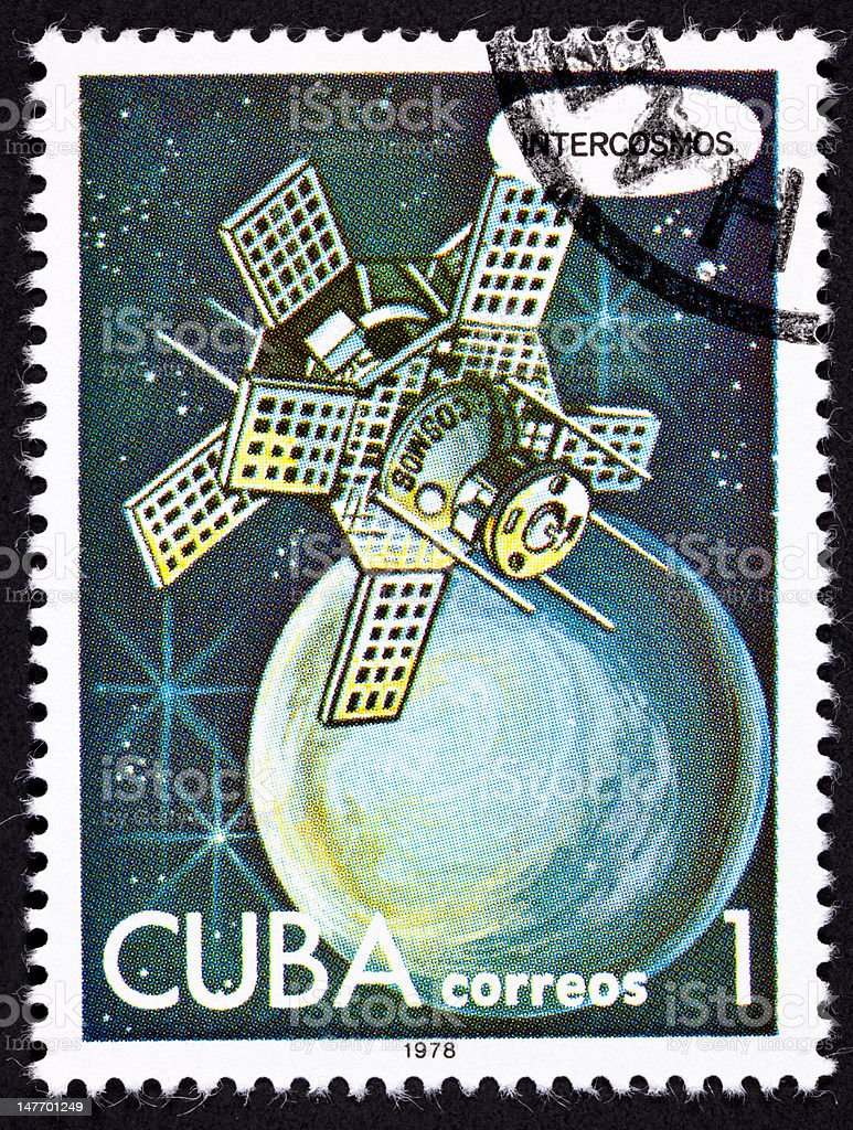 Canceled Cuban Postage Stamp Intercosmos Satellite Orbiting Planet in Space royalty-free stock photo