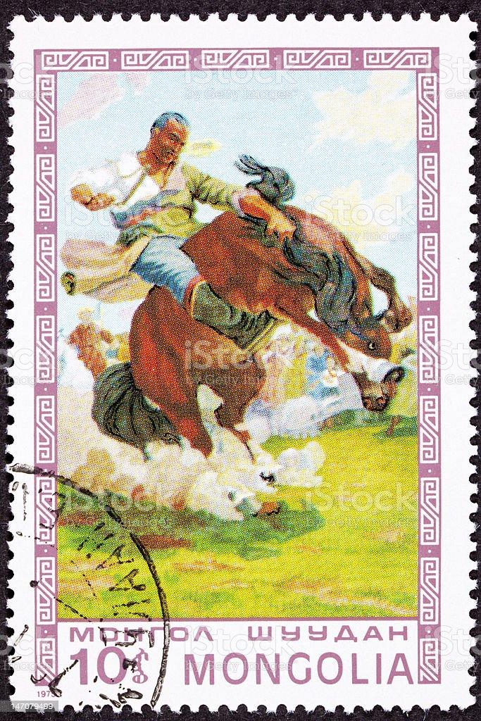 Canceled Mongolian Postage Stamp Bucking Bronco Man Breaking Wild Horse royalty-free stock photo