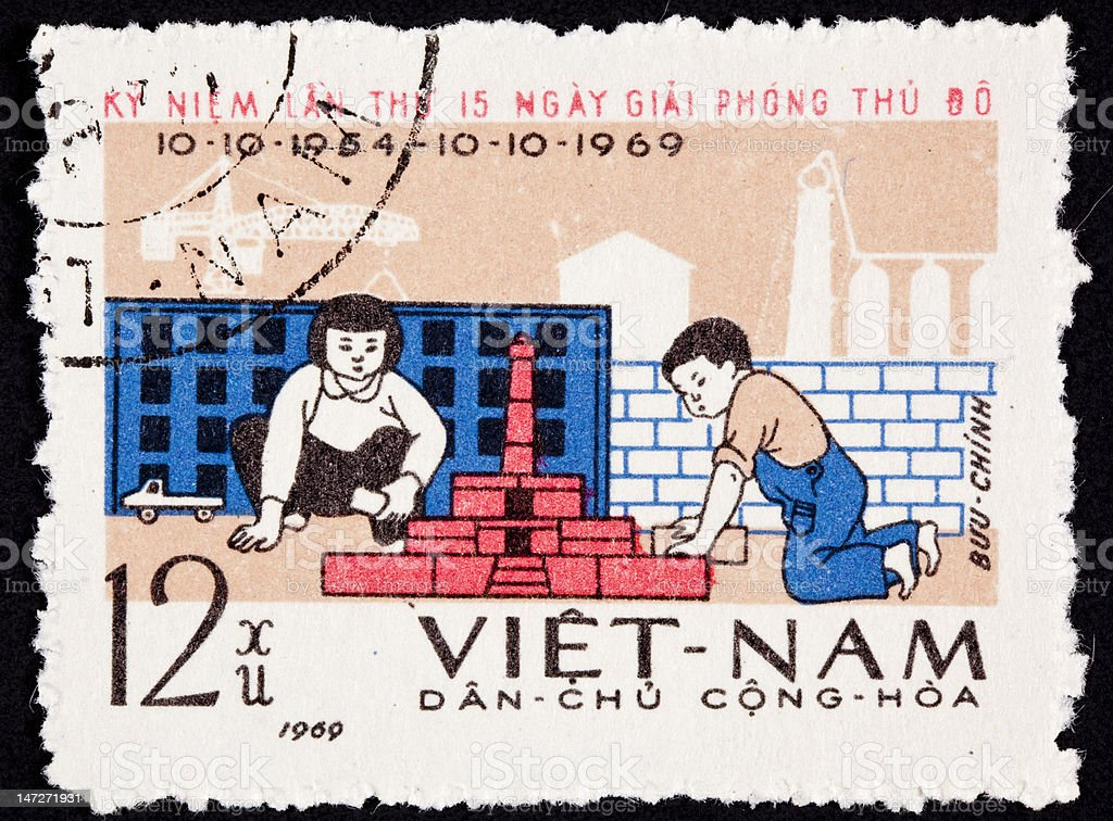 Canceled North Vietnamese Postage Stamp Children Playing Building City Blocks royalty-free stock photo