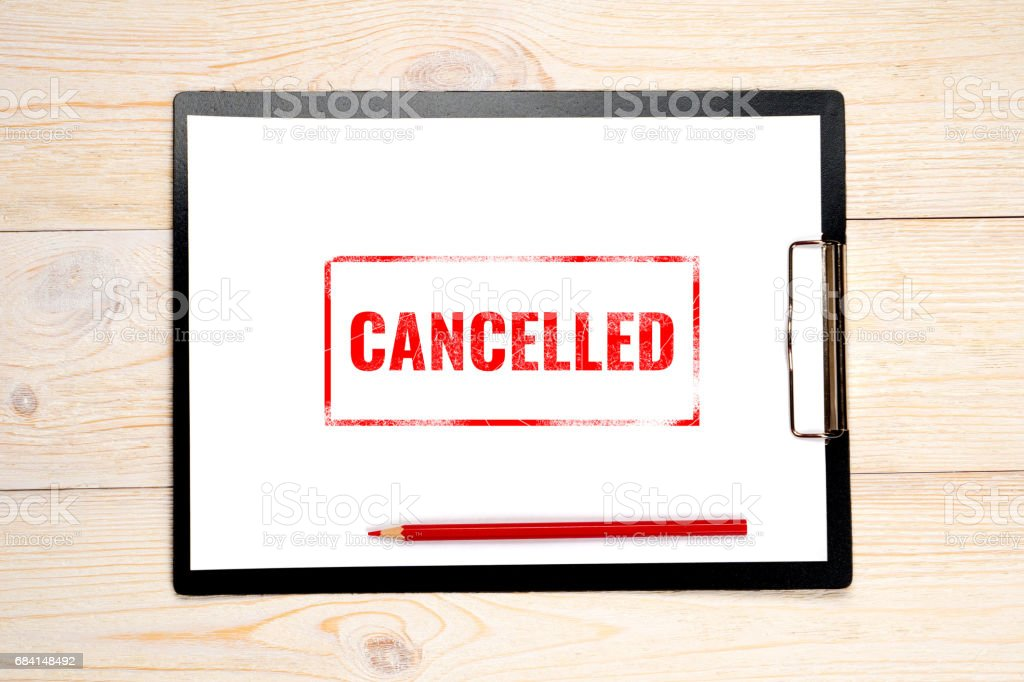 canceled red stamp on empty paper stock photo