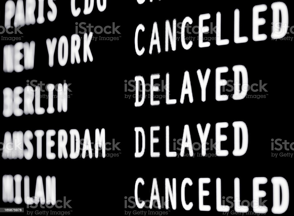 Cancelled and delayed flights on a airport screen stock photo