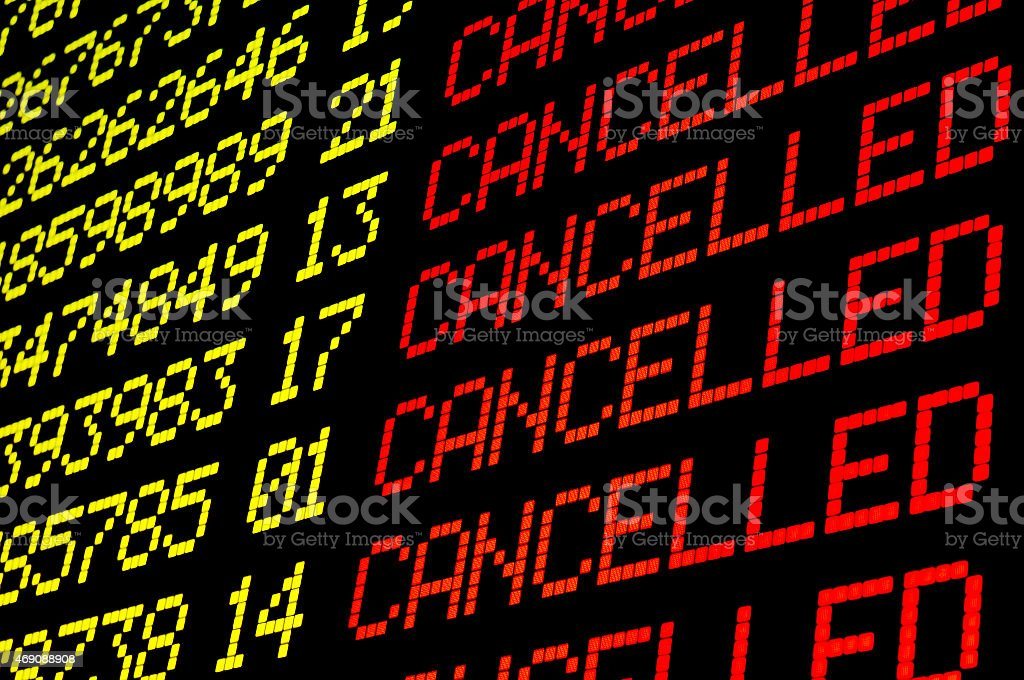 Cancelled flights on airport board stock photo