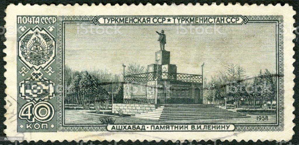Cancelled Stamp From The USSR shows Lenin statue, Ashgabat, Turkmen Soviet Socialist Republic, Capitals of Soviet Republics stock photo