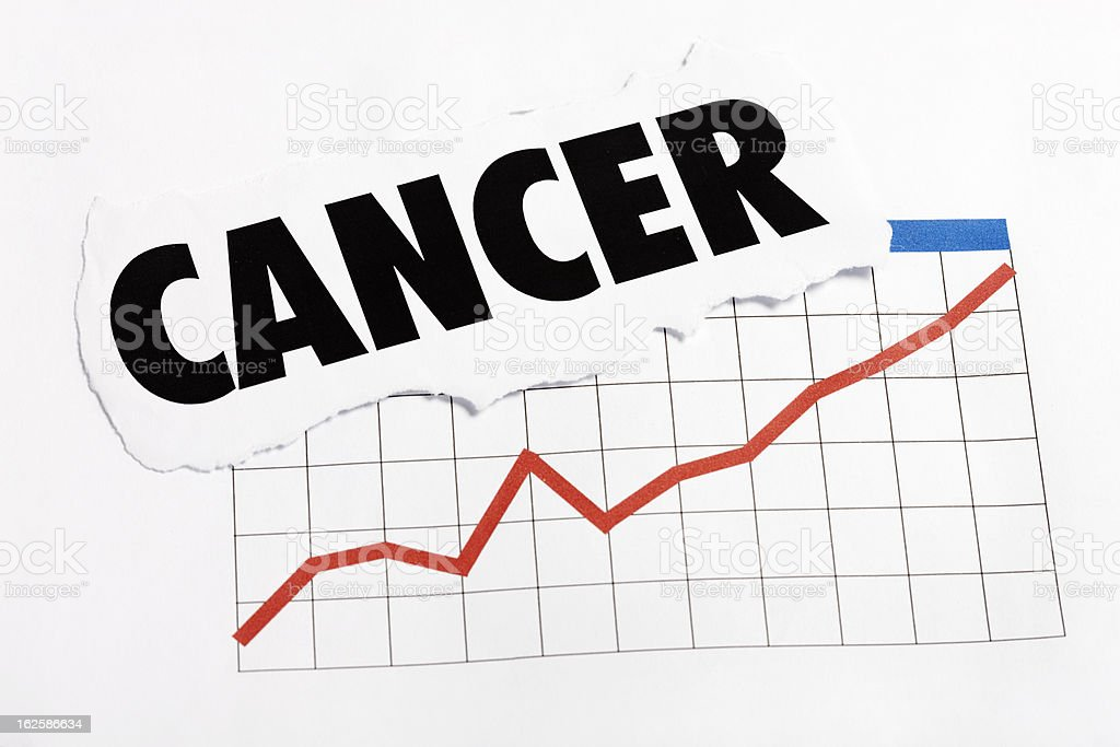 Cancer headline rests on ominous rising graph stock photo