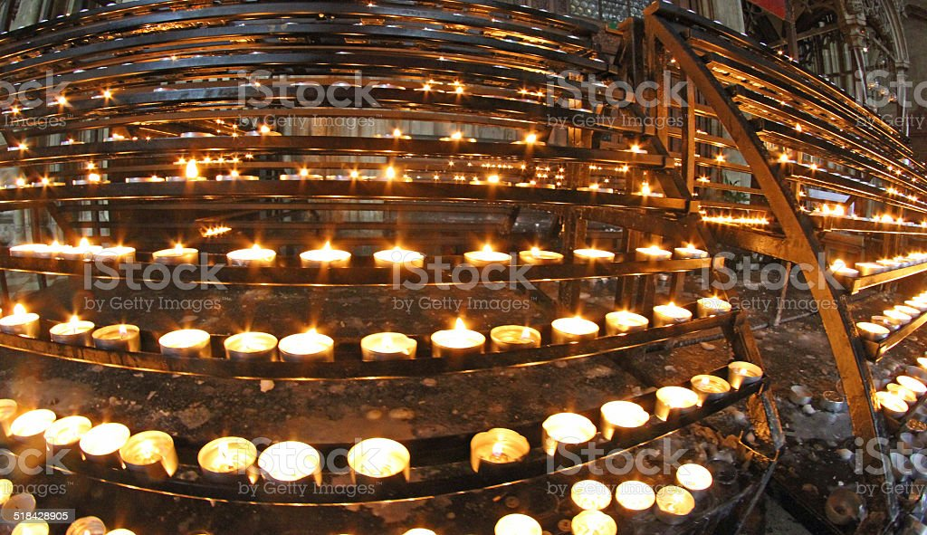 candelabrum in church with many wax candles and flickering flame stock photo