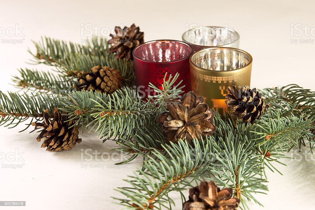 candels and christmas tree on the white background stock photo
