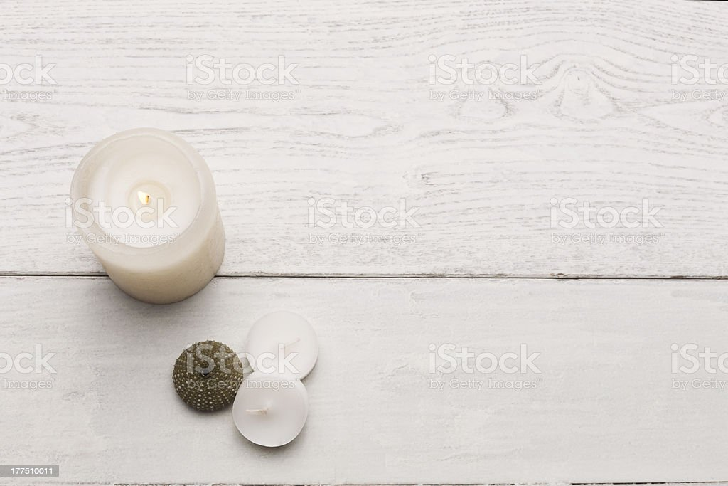 Candels on white hardwood stock photo