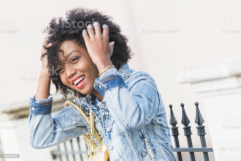 Candid face of a young mixed race African American woman stock photo