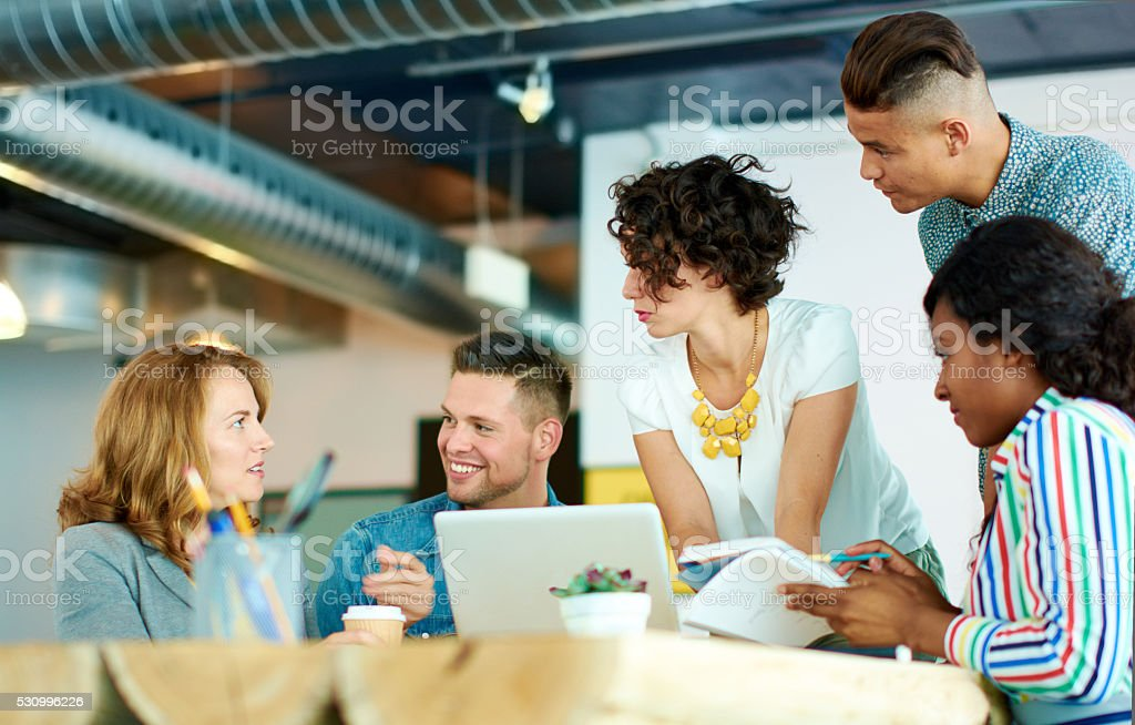 Candid image of a group with succesful business people caught stock photo