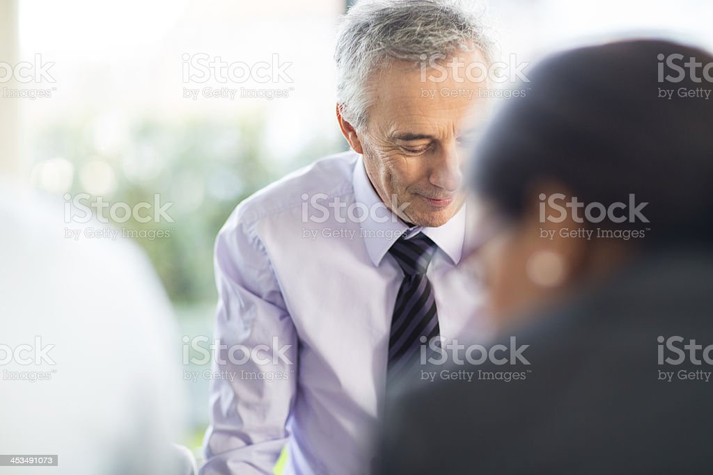 Candid image of business man at a meeting royalty-free stock photo