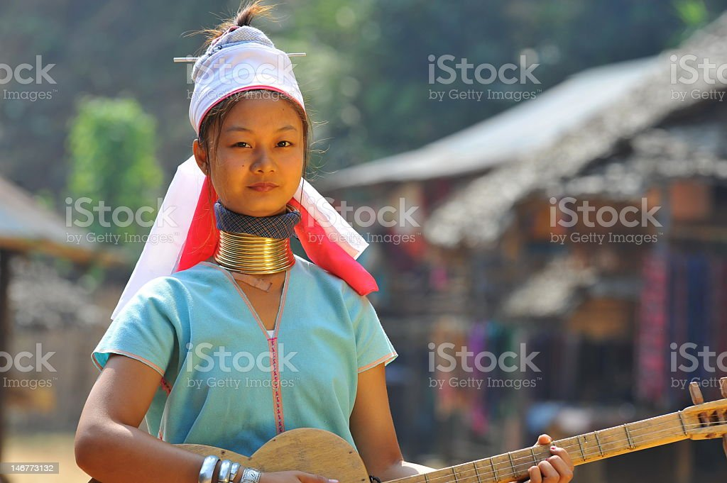 Candid image of young woman with a guitar stock photo