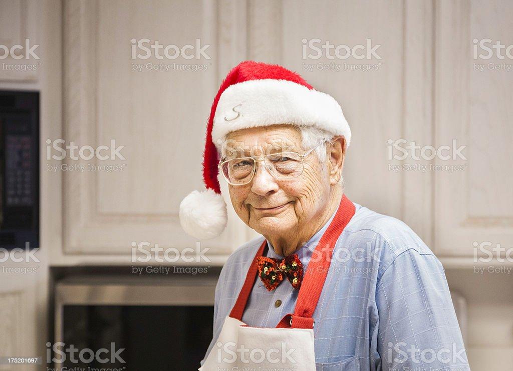 Candid photo of Chef Grandpa Santa in kitchen royalty-free stock photo