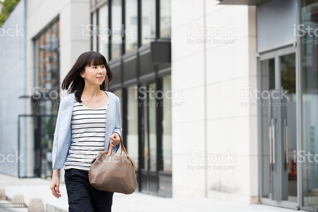 Candid portrait attractive Japanese woman in street stock photo