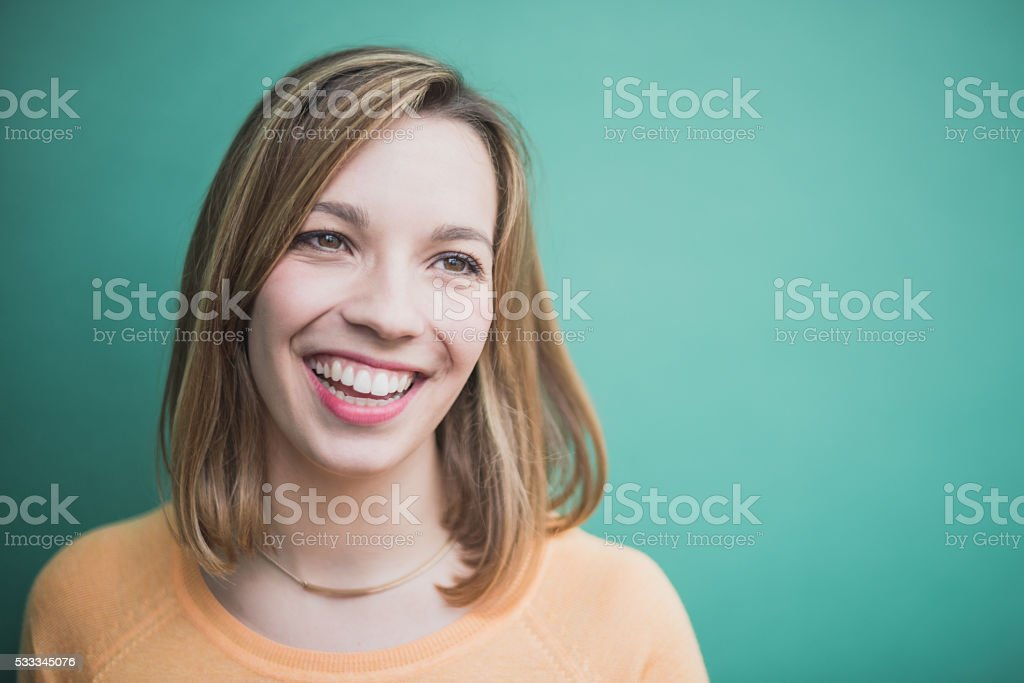 Candid portrait of a laughing and smiling young woman stock photo