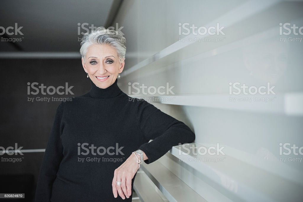 Candid portrait of mature businesswoman in modern office stock photo