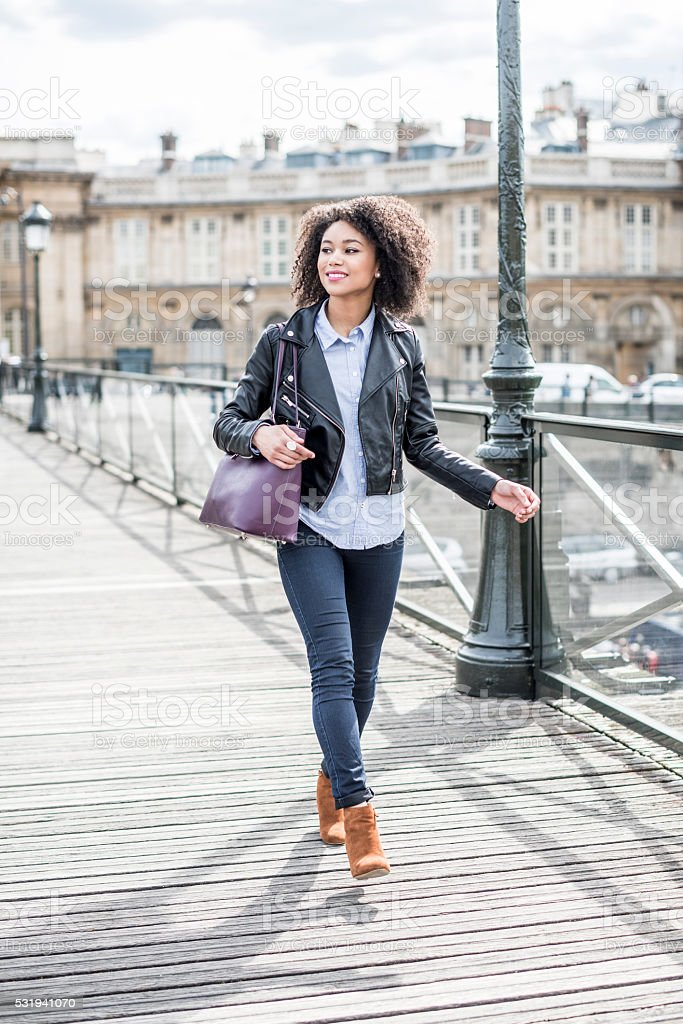 Candid portrait of mixed race woman on wooden path stock photo